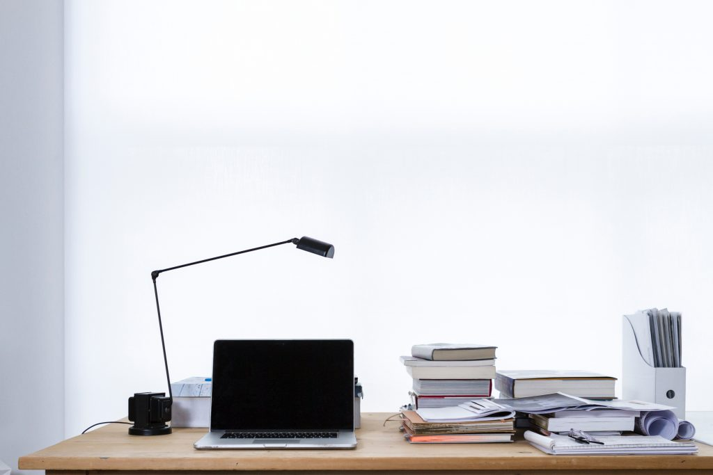 Photo of desk with books Photo by freddie marriage on Unsplash
