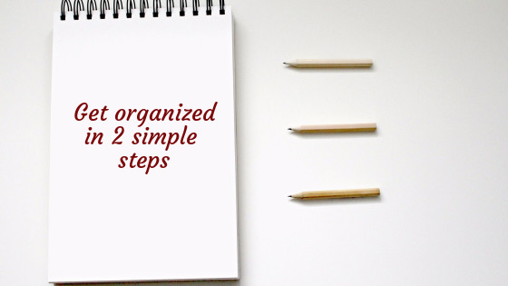 How to get organized in 2 simple steps: notebook with this written title