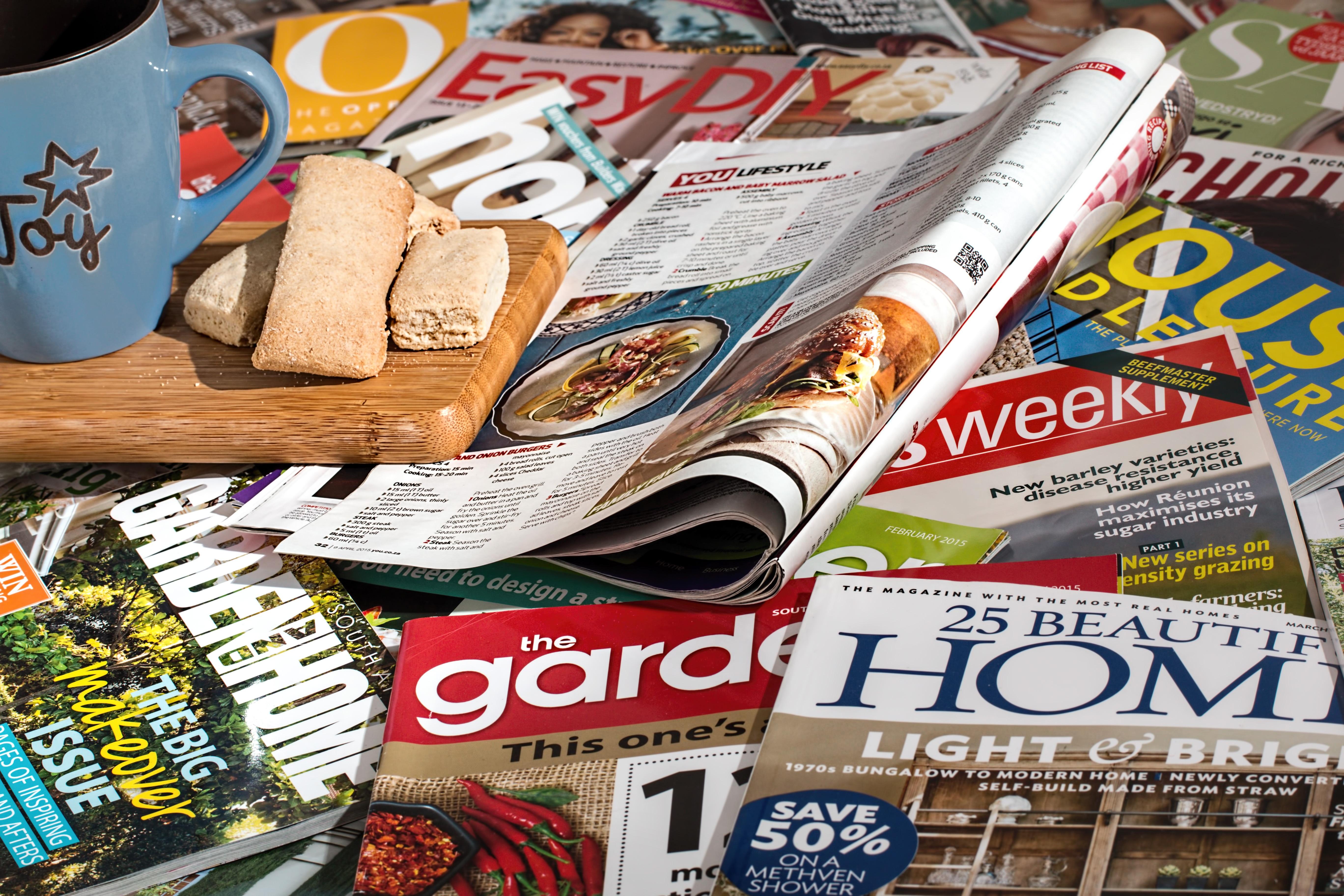 Magazines, mug of tea and bread
