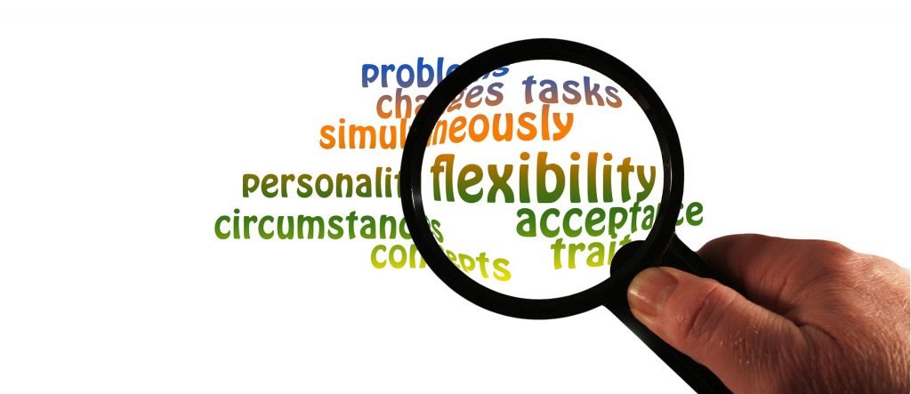 how to get organized: be flexible. Magnifying glass emphasizing the word flexibility