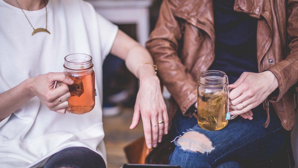 Friends drinking tea. Photo by Matthew Henry on Unsplash