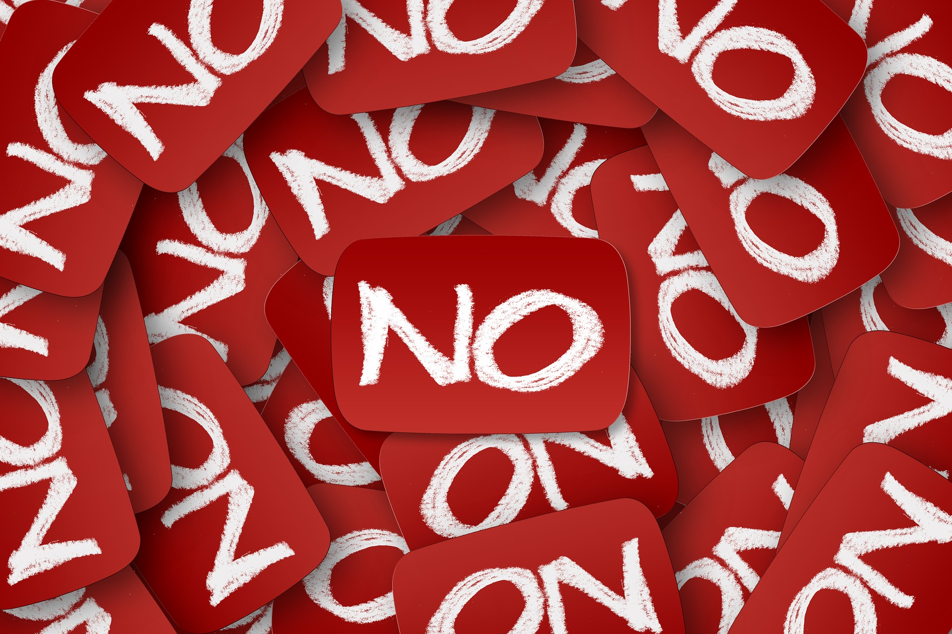 "White word ""no"" on red background"