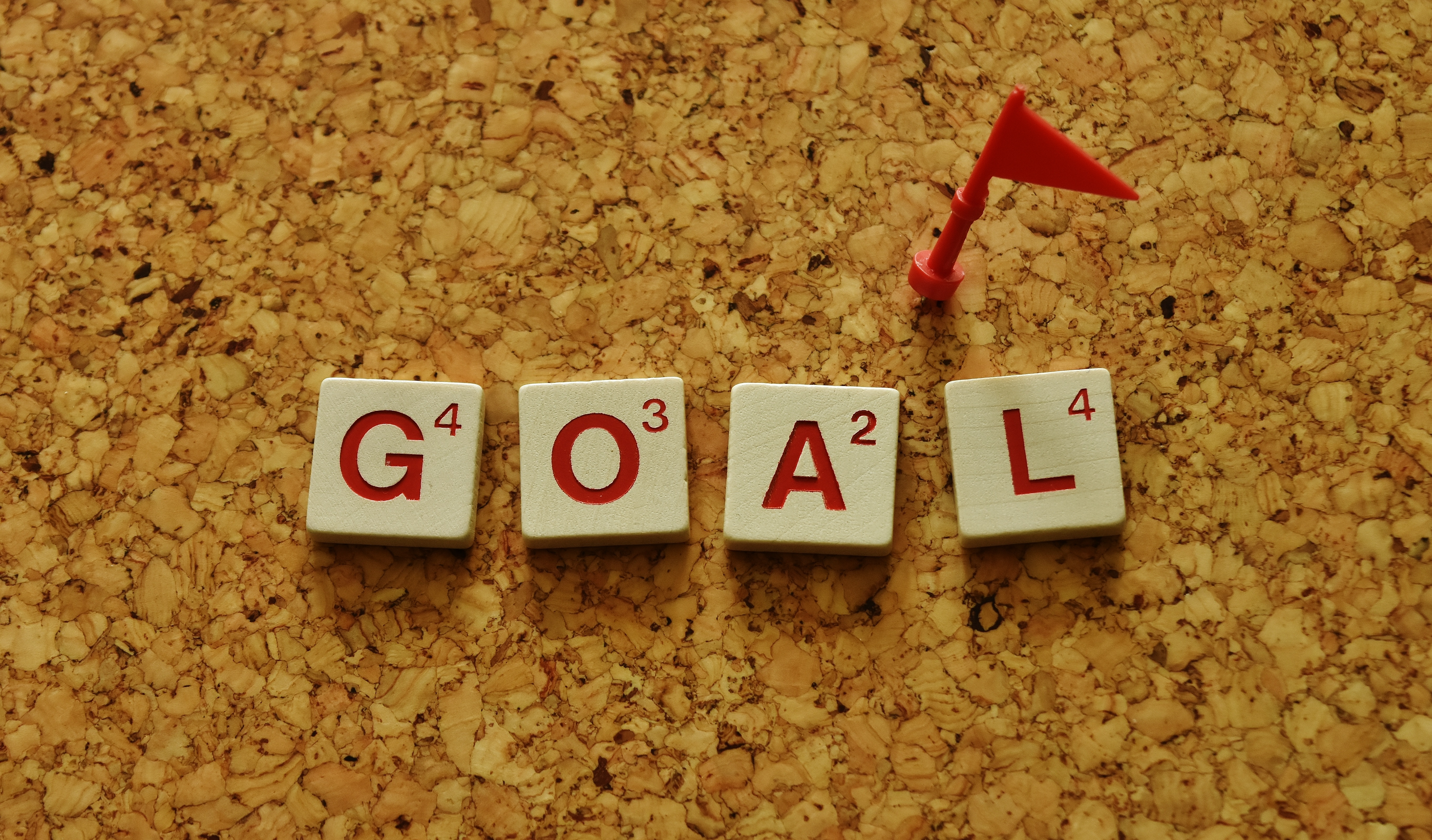 Goals spelled out in red Scrabble tiles