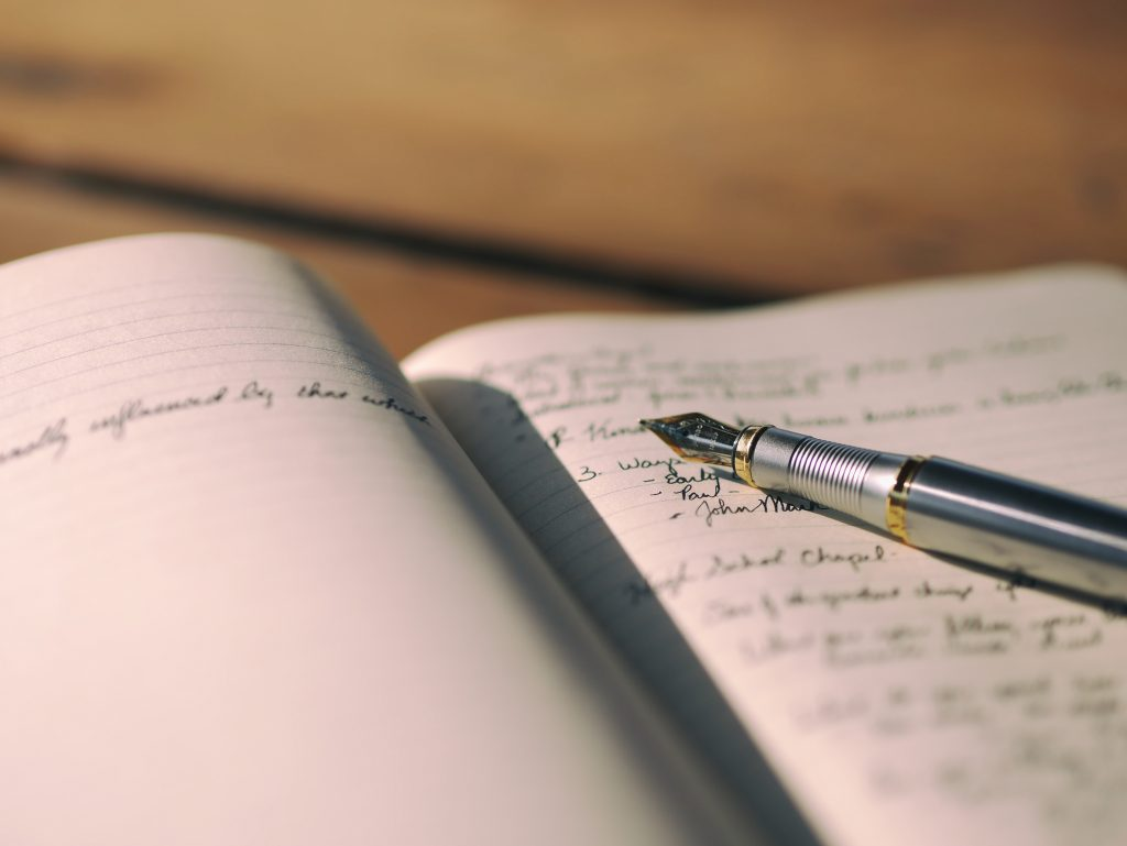 fountain pen and notebook Photo by Aaron Burden on Unsplash how to start a writing career