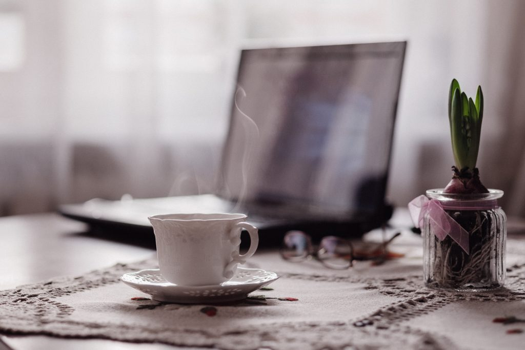 steaming coffee with laptop in background Photo by freestocks.org on Unsplash