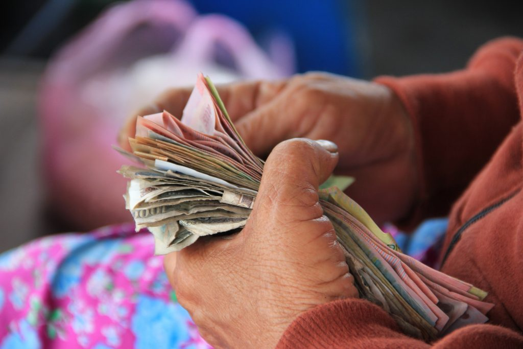 woman counting money; payment, Photo by Niels Steeman on Unsplash