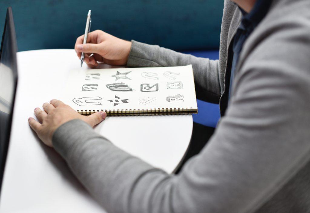 Graphic Designer sketching Photo by rawpixel.com on Unsplash