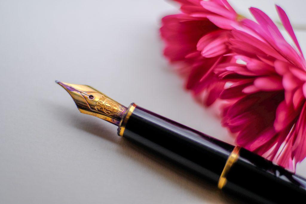 fountain pen and flower Photo by John Jennings on Unsplash