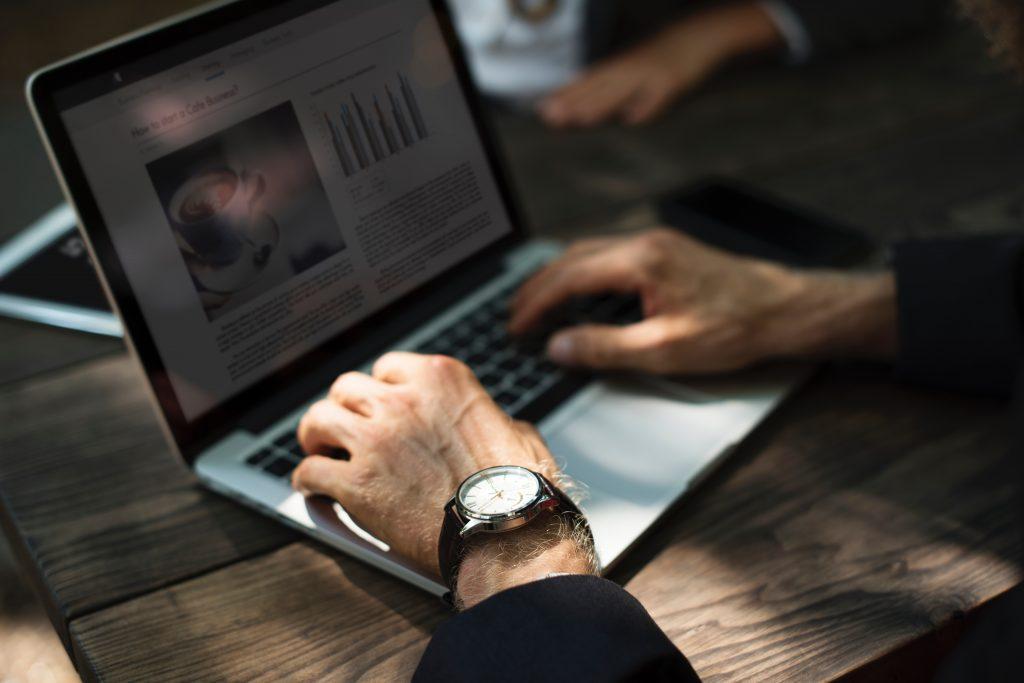 man typing on laptop Photo by rawpixel.com on Unsplash