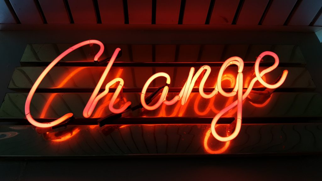 change neon sign Photo by Ross Findon on Unsplash