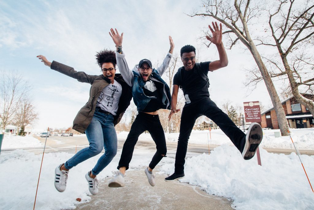 3 friends jumping Photo by Zachary Nelson on Unsplash