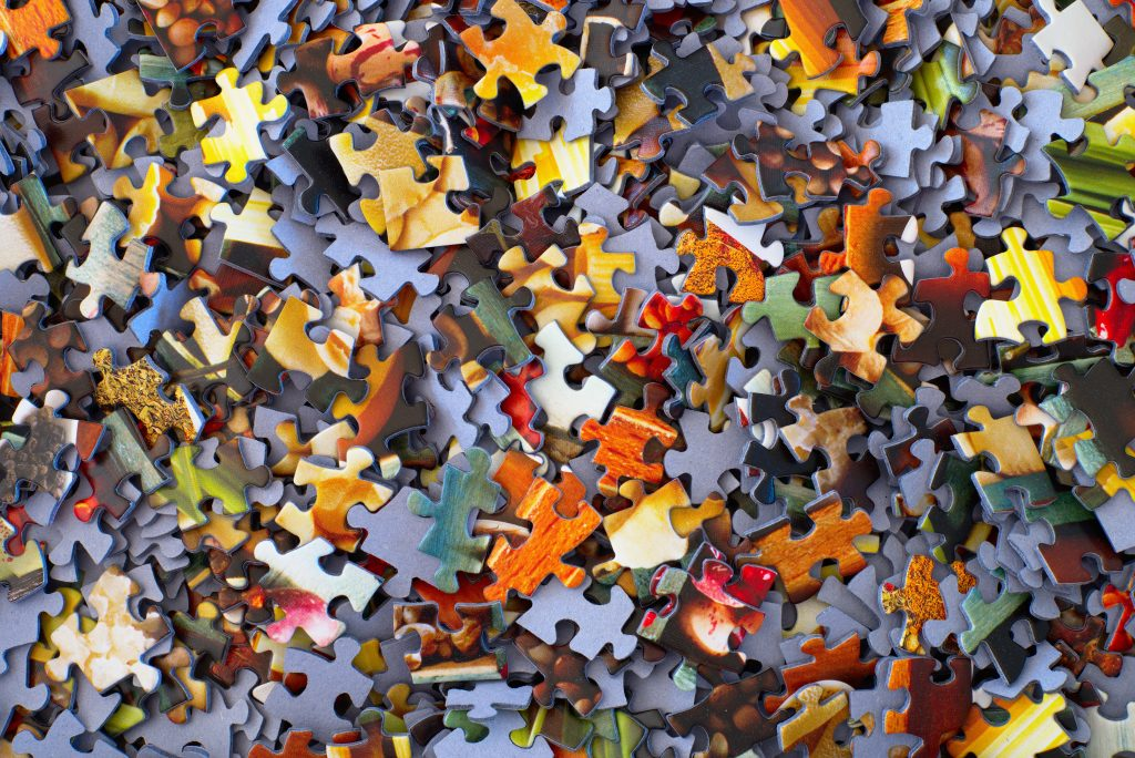Puzzle pieces to represent table top games mind map; Photo by Hans-Peter Gauster on Unsplash