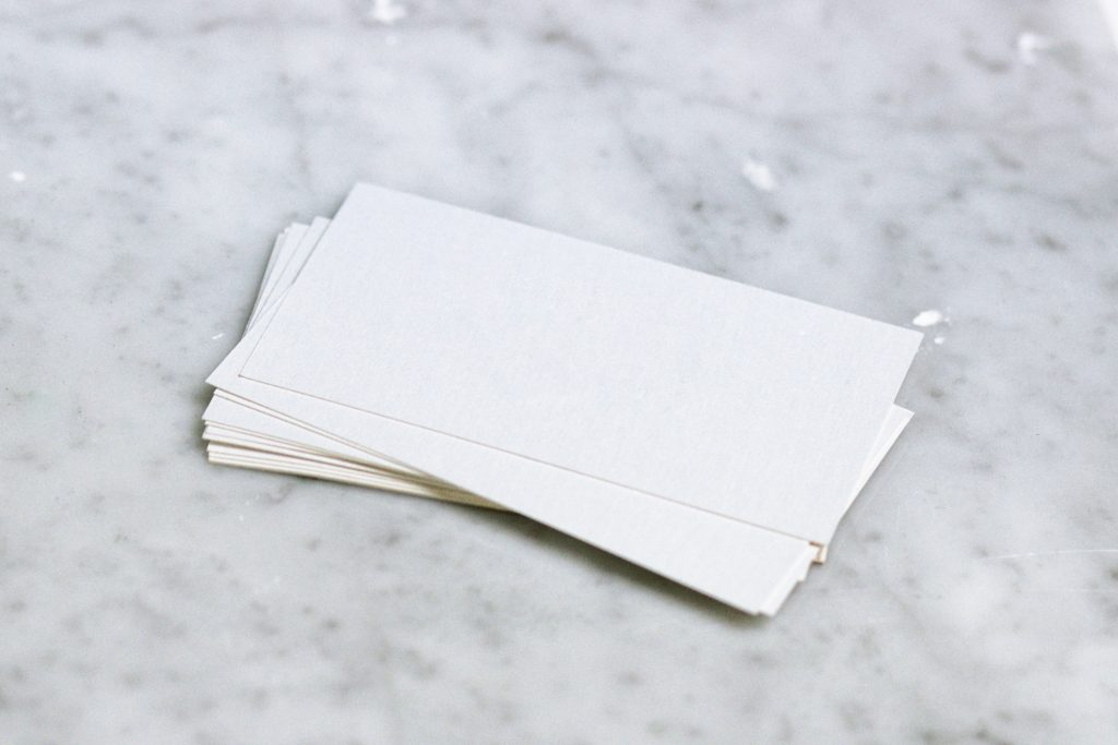 blank business cards; CamCard app; Photo by Kate Trysh on Unsplash