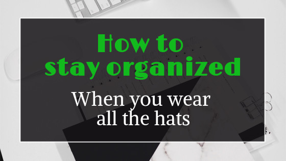 title graphic: how to stay organized when you wear all the hats. Organized desk in background