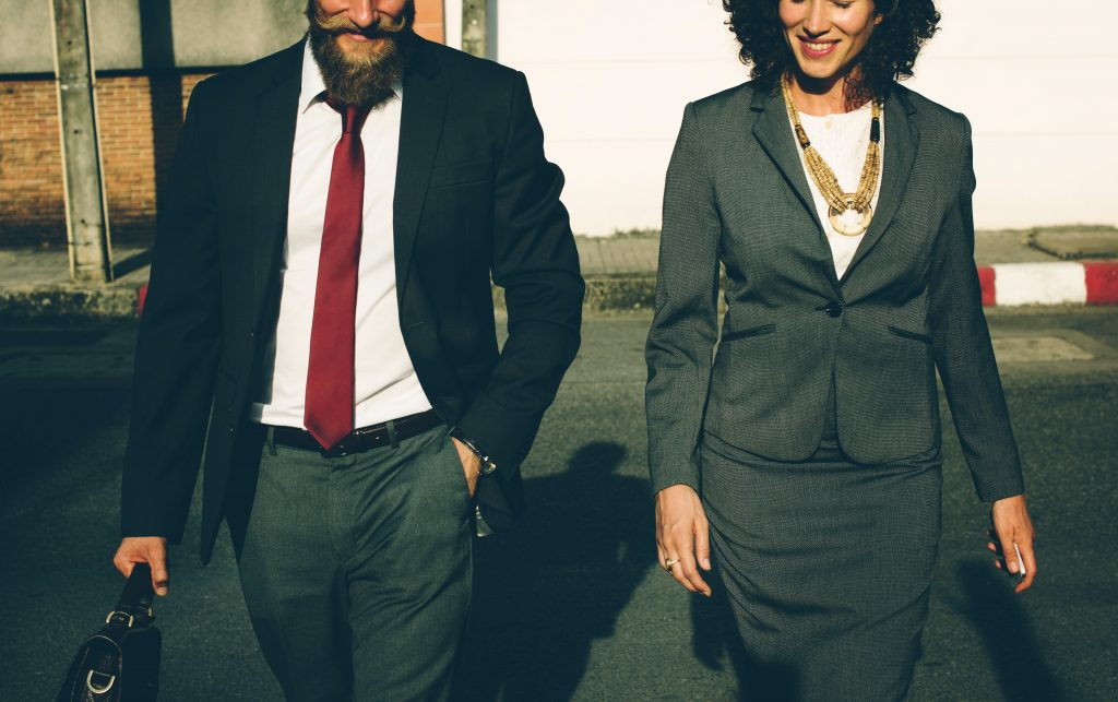 Man and woman in business suits; business mind map; mind maps for freelance writing success; Photo by rawpixel.com on Unsplash