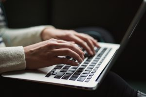 hands typing on laptop, Photo by Kaitlyn Baker on Unsplash How to make a living as a writer