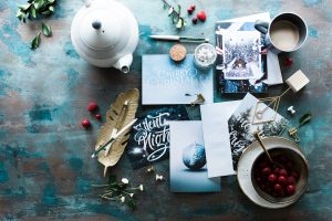 Greeting cards, tea pot, etc. Photo by Brooke Lark on Unsplash