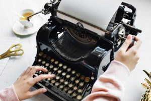 Woman's hands typing on typewriter, Photo by rawpixel on Unsplash