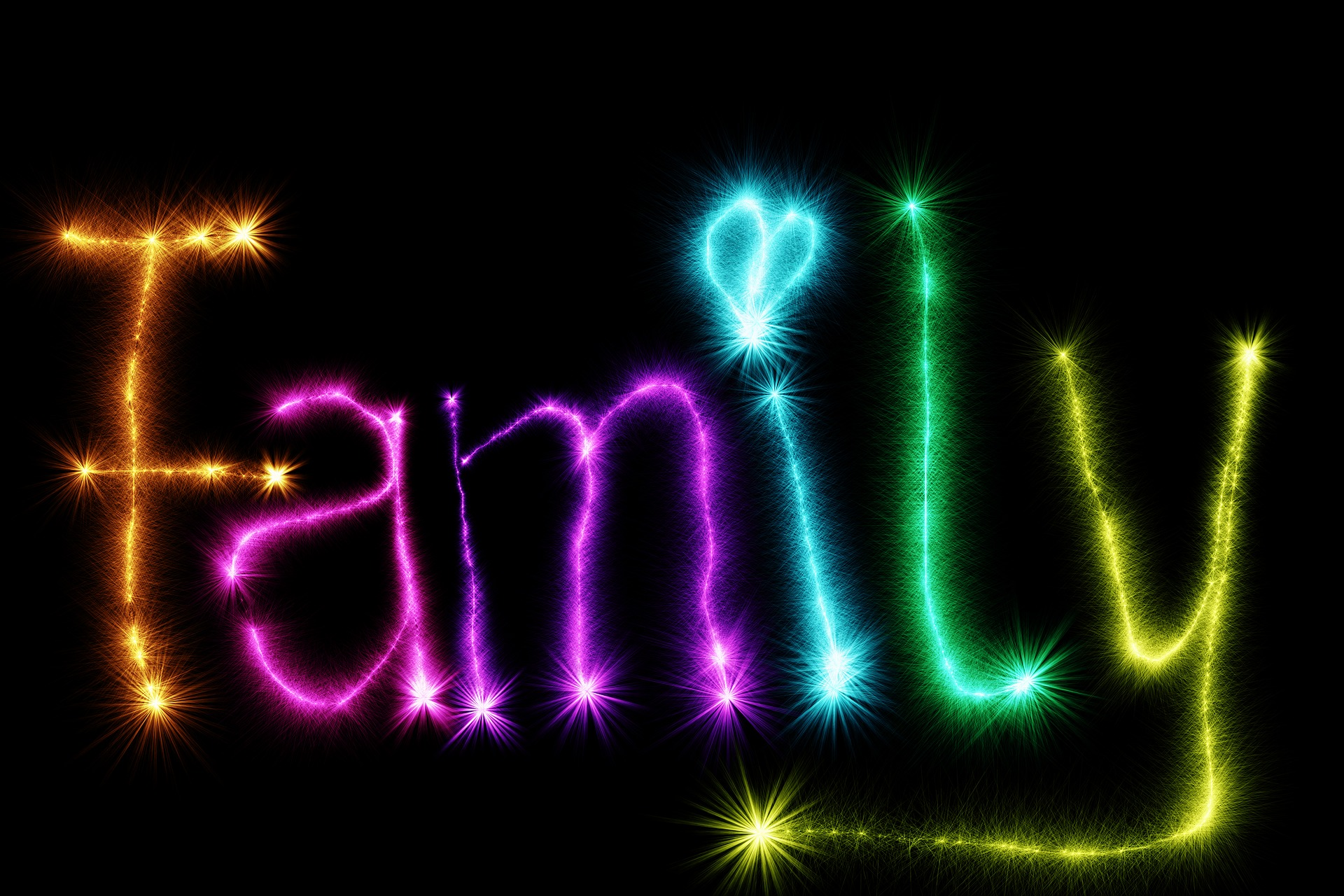Family sign written in neon letters, with a heart instead of a circle on top of the i.