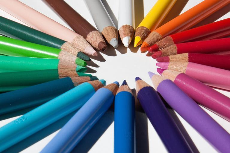 free stock photo of coloured pencils arranged to form a circle in the middle.