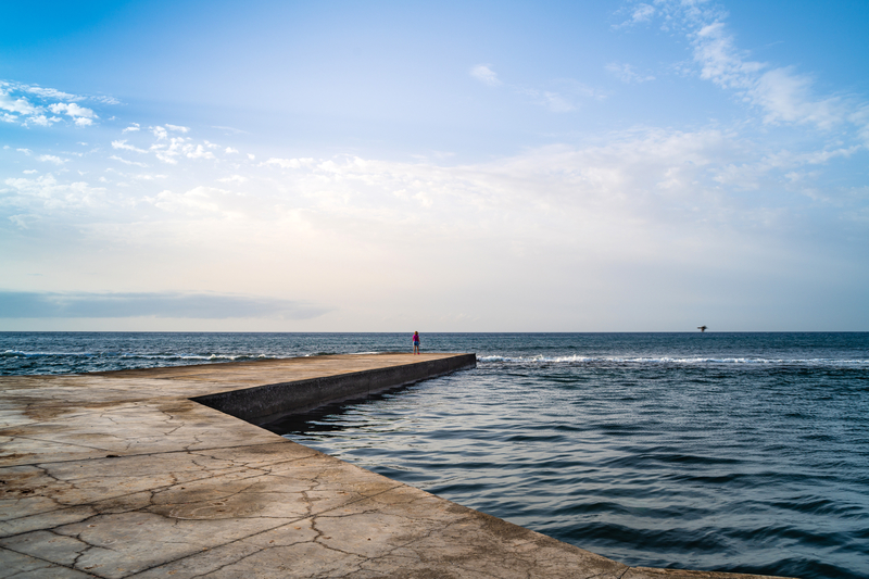 free stock photo of person standing on concrete pier