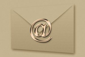 digital rendering of an envelope with the @ symbol as a seal. Email marketing: how to grow your audience with an email list