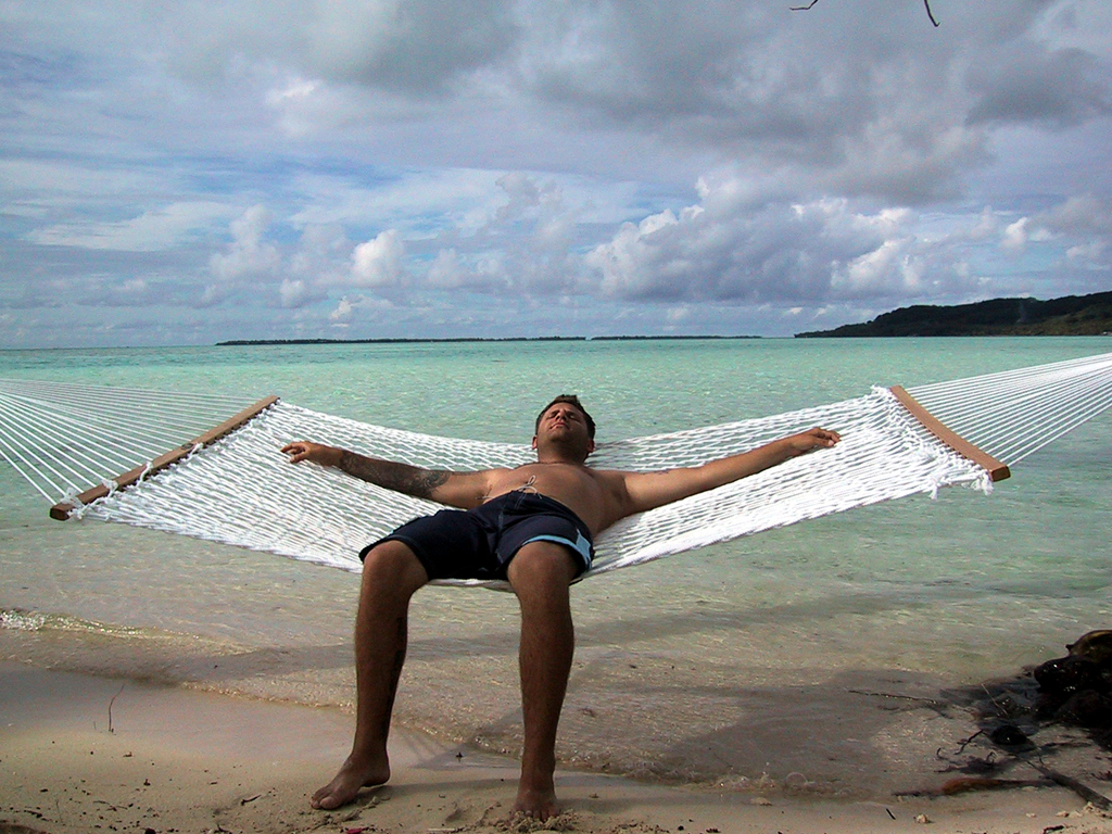 Man on a hammock at the beach
