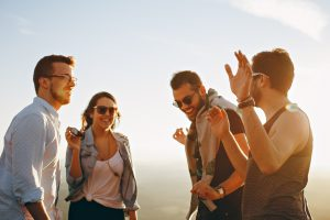 Group of friends laughing and talking, Photo by Helena Lopes on Unsplash