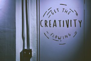 "Sign on a wall that says ""Get the CREATIVITY flowing"" Photo by Tim Mossholder on Unsplash"