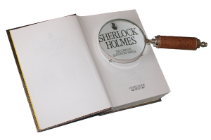 "magnifying glass on open book, ""Sherlock Holmes."" Famous multi-genre author, www.marianamcdougall.com"