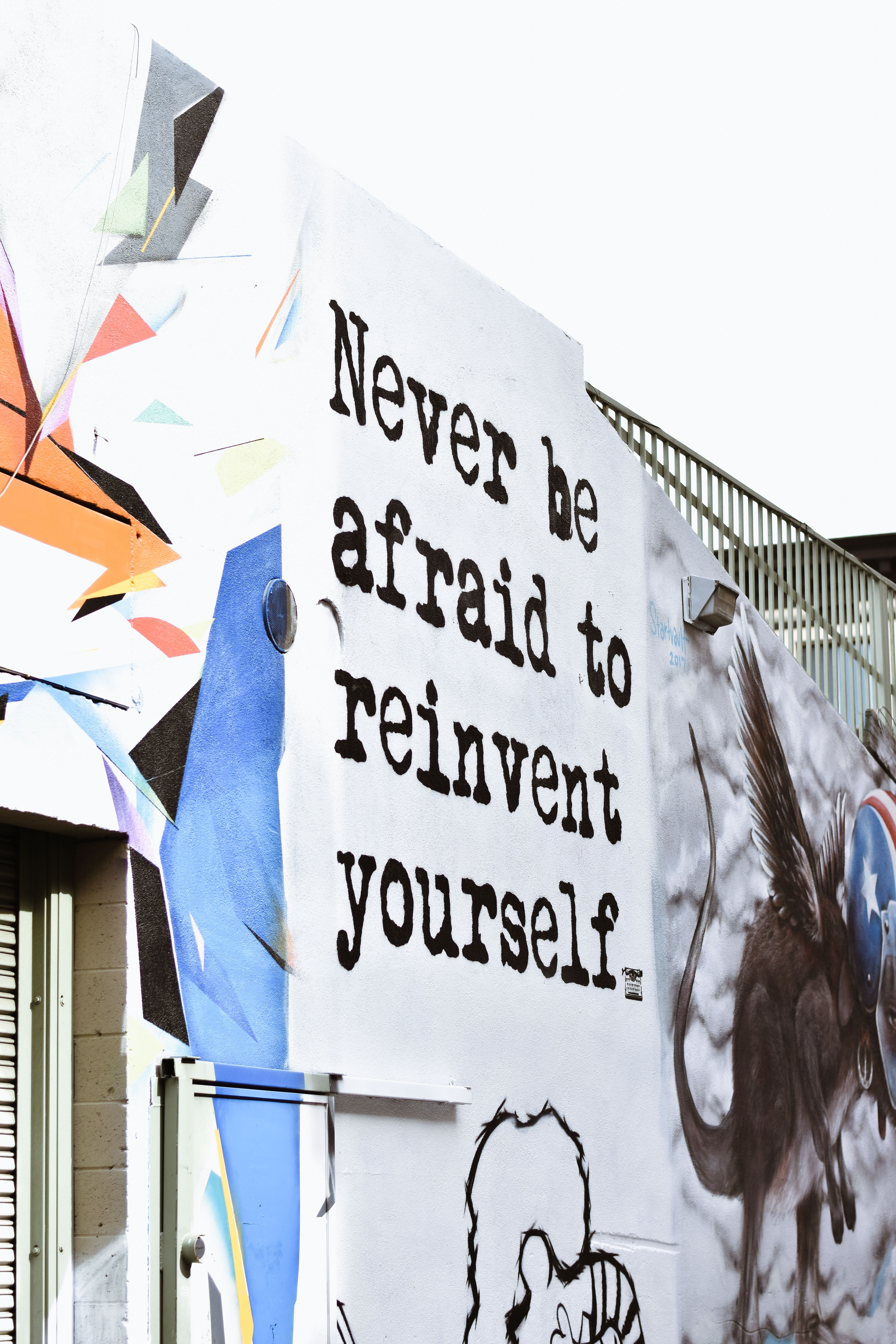 "Poster with the words ""Never be afraid to reinvent yourself."" Photo by Allie Smith on Unsplash"