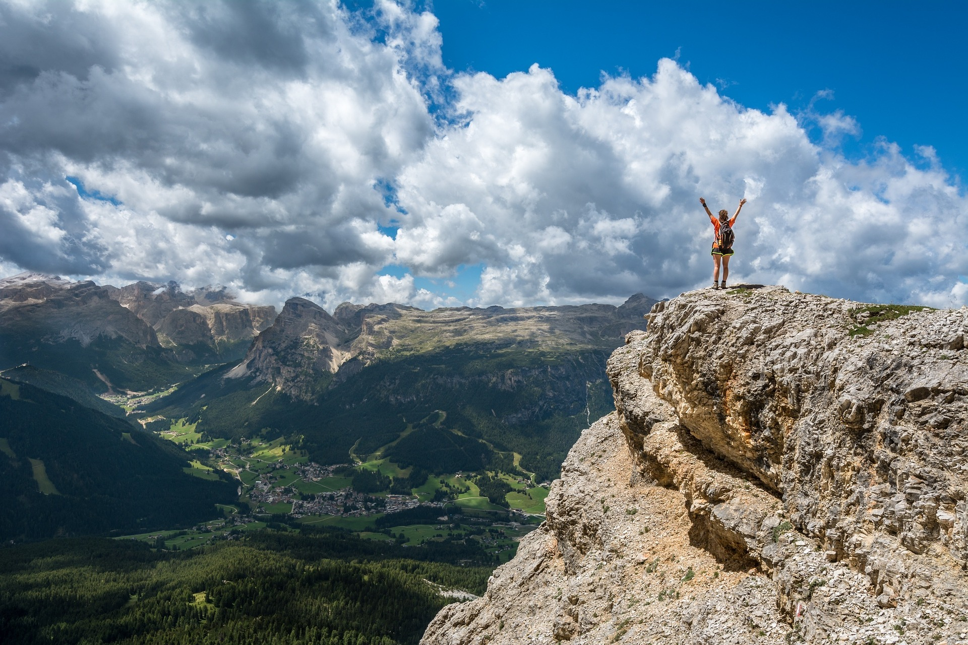 person standing at the top of a mountain. Photo by Free-Images on Pixabay. Personal Development Mind Ma on MultiTalented Writers