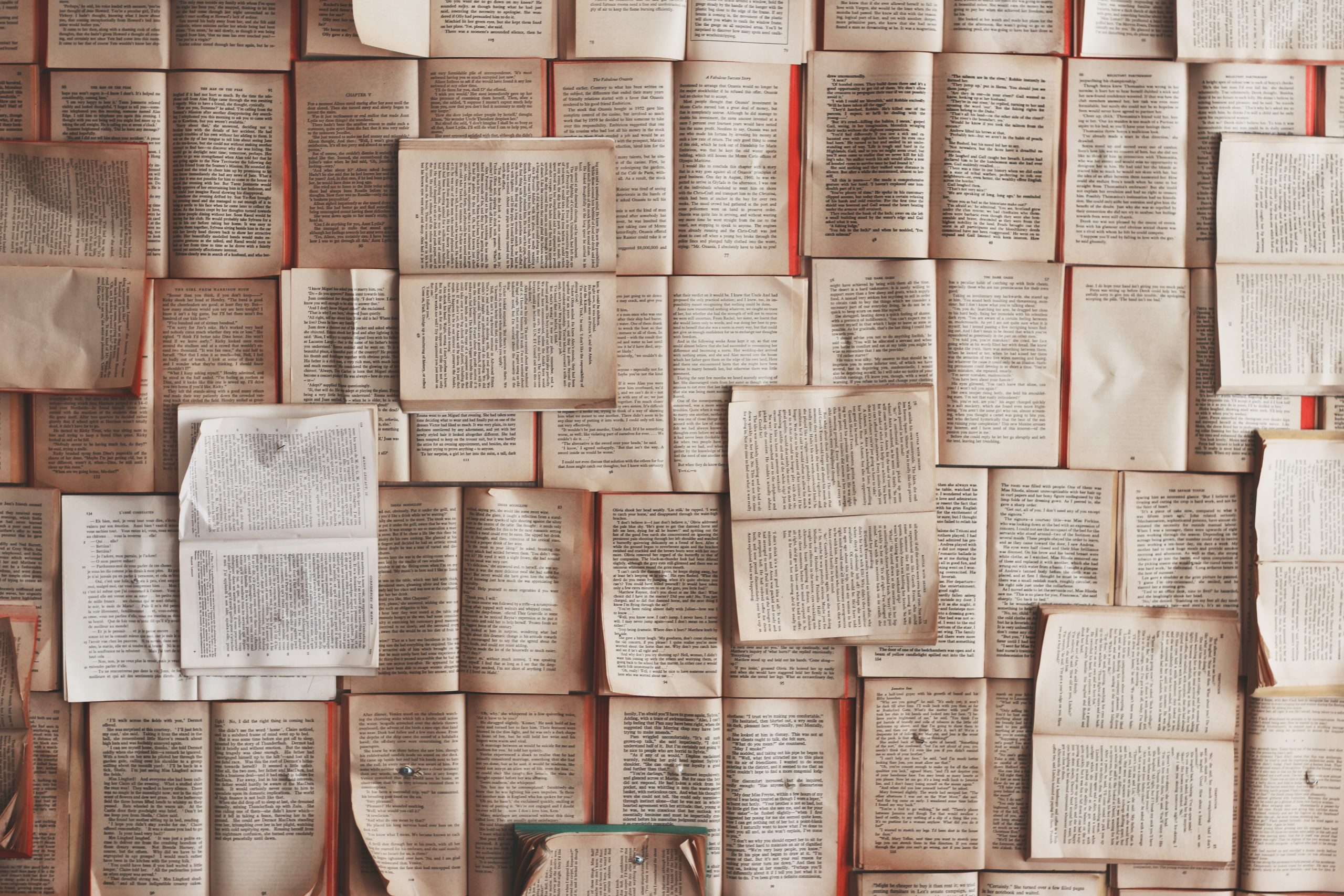 Publishing. Picture of several open books as seen from above. Photo by Patrick Tomasso on Unsplash.