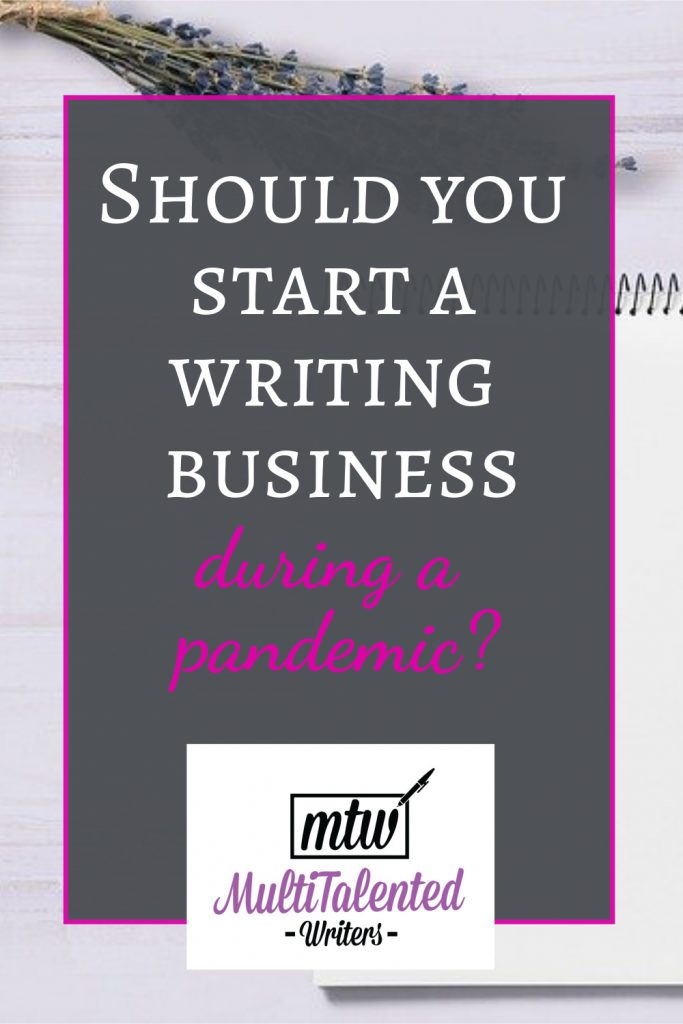 Should you start a writing business during a pandemic? background photo of a notepad and a sprig of flowers.